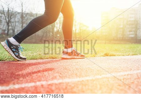 Sportswoman Practicing Jogging In The Stadium, Outside. Morning Workout Outdoors. Woman Running On R