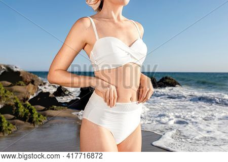 Basic white bikini top close up swimwear shoot at the beach