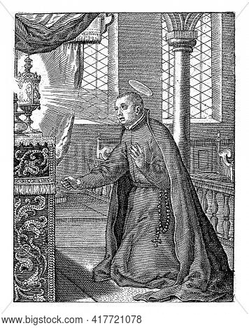 Stanislaus Kostka, a Polish Jesuit, canonized in 1726. Saint Stanislaus is kneeling in front of an altar on which a radiant chalice.