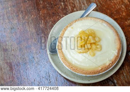 A Piece Of Homemade Pineapple Tart On Wooden Table. Tarts Is A Baked Dish And Usually Fruit-based, S