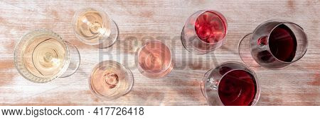Wine Color Panorama With Many Different Glasses, A Flat Lay
