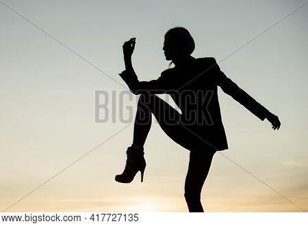 Start Dancing. Dance Girl On Evening Sky. Dancing Silhouette. Woman Ballet Dancer In Dusk