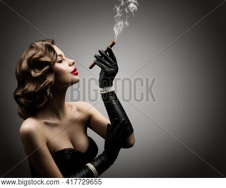 Retro Woman Smoking Cigar, In Corset And Gloves, Beautiful Old Fashioned Model Portrait Over Gray St