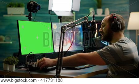 Cyber Streamer Playing Online Videogames On Green Screen Powerful Computer