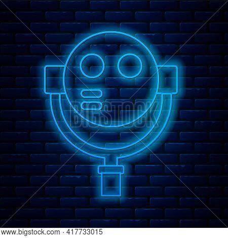 Glowing Neon Line Tourist Binoculars Icon Isolated On Brick Wall Background. Binoculars Telescope On