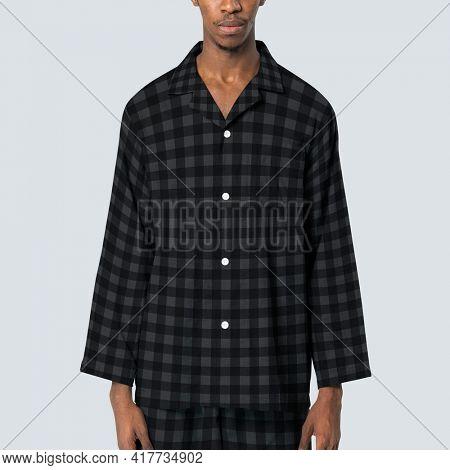 Man in black plaid pajamas sleepwear apparel