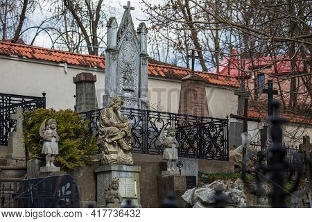 Vilnius, Lithuania - April 10, 2021: Ancient Tombstones And Statues In The Bernardine Cemetery, One