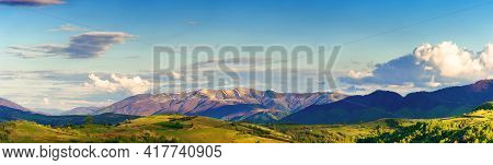 Mountainous Rural Panorama Landscape In Springtime. Beautiful Scenery Beneath A Sky With Clouds. Gra