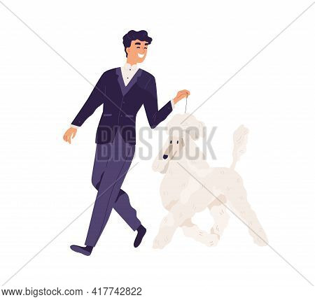 Happy Smiling Man In Elegant Formal Suit Walking With Dog. Pet Owner Leading His Royal Poodle On Lea