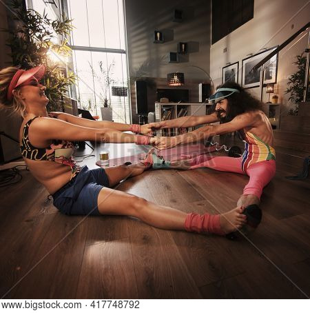 Sporty hipster couple home training