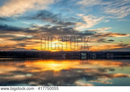 Sunset on the lake with beautiful reflections in the water