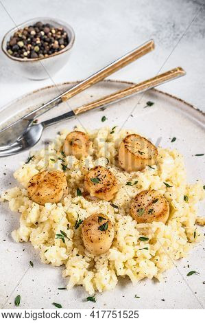 Italian Risotto With Pan Seared Sea Scallops. White Background. Top View