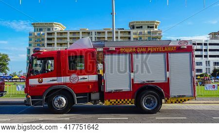 Labuan,malaysia-july 5,2019:malaysian Red Fire Engine On Street Of City Near Labuan Town At Labuan F