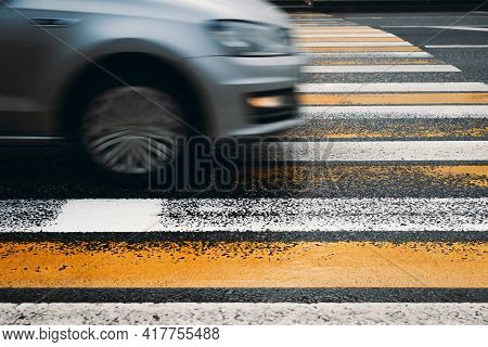 Car Driving Into A Pedestrian Crossing. Motion Blur, Selective Focus. Violation Of Traffic Rules, Ro