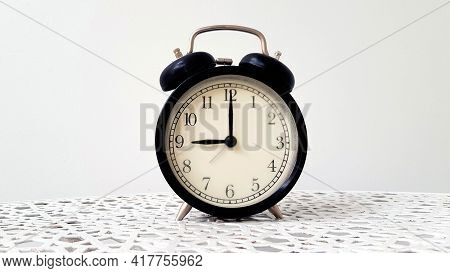 Vintage Clock On Table Isolated On White Background With Copy Space. Retro Object. 9 O' Clock. Morni