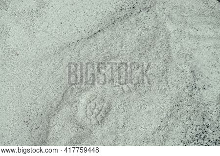 Boot Protector On Shiny Sandy Surface. Minimalist Nature Background With Boot Print On Sand. Minimal