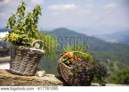 Sacro Monte (va), Italy - June 01, 2020: A Basket With Flowers At Pilgrimage Village Of Santa Maria
