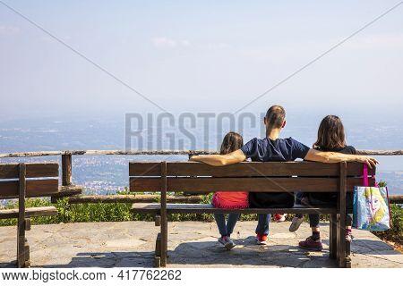 Sacro Monte (va), Italy - June 01, 2020: Tourists Look Landscape At Top Hill At Campo Dei Fiori Regi