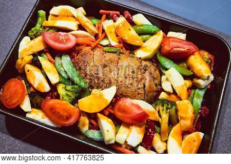 Vegan Roast With Mixed Garden Vegetables And Plant-based Meatloaf Before Going In The Oven, Healthy