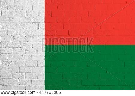Flag Of Madagascar. Brick Wall Texture Of The Flag Of Madagascar.
