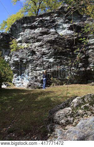 Sesto Calende (va), Italy - September 15, 2016: A Tourist Near The Gigantic Stone Named Sass Da Prej