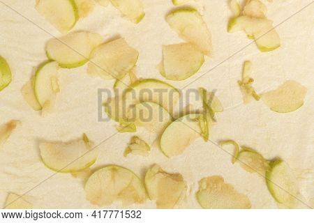 Pieces Of Apples Are Laid Out On Top Of The Dough. Apple Pie Making Process.