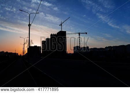City Evening Landscape. Evening Silhouettes Of Multi-storey Residential Buildings Under Construction