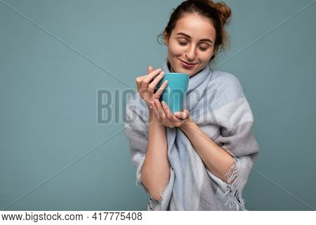 Beautiful Young Happy Smiling Brunette Woman Wearing Warm Blue Scarf Isolated Over Blue Background H