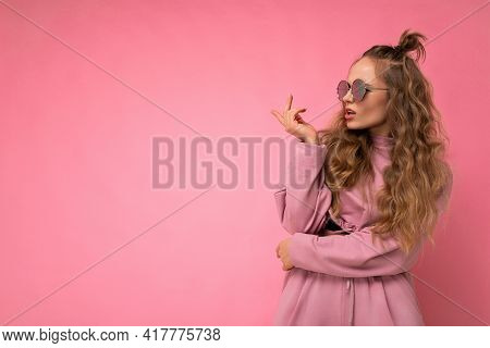 Attractive Dissatisfied Asking Young Blonde Woman Wearing Everyday Stylish Clothes And Modern Sungla