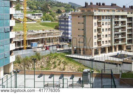 Oviedo, Spain - April 20, 2020: Construction Of A Residential Building In An Ecological Natural Area