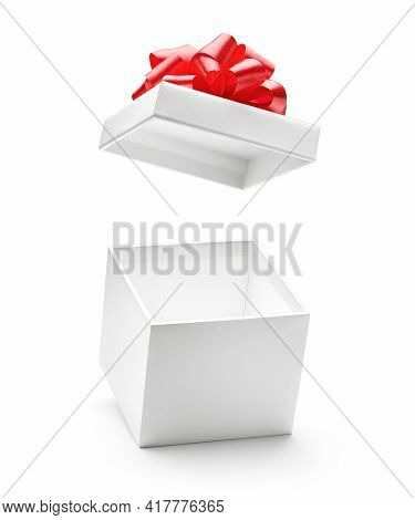 White Color Open Gift Box With Red Bow Isolated On White Background