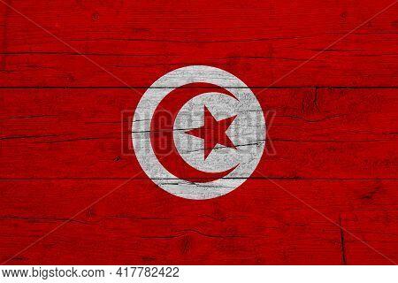 Flag Of Tunisia. Wooden Texture Of The Flag Of Tunisia.