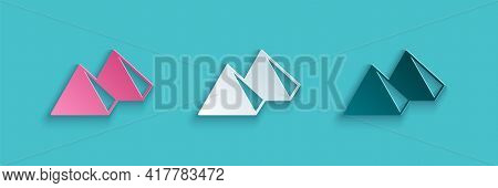 Paper Cut Egypt Pyramids Icon Isolated On Blue Background. Symbol Of Ancient Egypt. Paper Art Style.