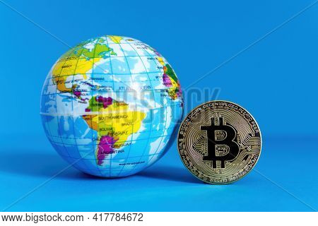 Bitcoin Btc Crypto Currency Gold Coin And Earth Globe, Worldwide New Virtual Money Concept. Mining O