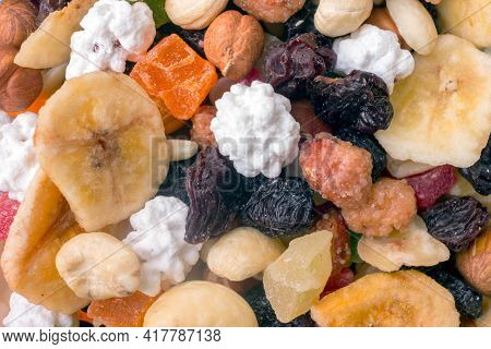 A Mixture Of Nuts, Dried Fruits And Nuts In The Glaze,  Background, Top Viev