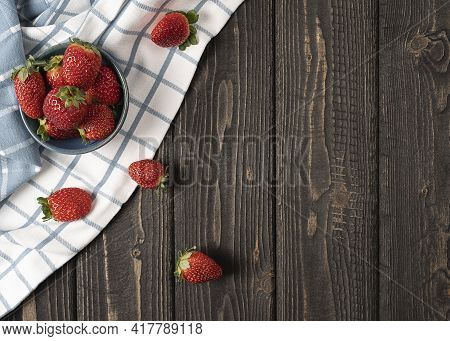 Corner Boarder Bowl With Strawberries And Scattered Berries On A Rustic Cotton Napkin, Plate With St