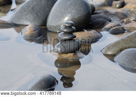Pebble Stack On The Beach The Stones Represent Balance And Wellbeing Of The Mind