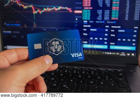 Berlin, Germany - April 21, 2021: Man Holding Crypto.com Debit Card In Hand. Crypto.com Is A Beginne