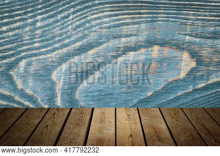 The Background Is Blank Wooden Boards And A Textured Wall With Lighting And Vignetting. For Product