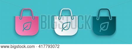 Paper Cut Paper Shopping Bag With Recycle Icon Isolated On Blue Background. Bag With Recycling Symbo