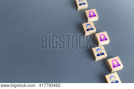 A Row Of Blocks With Employees. Recruiting And Staffing. Search And Recruitment Of New Employees. Hu