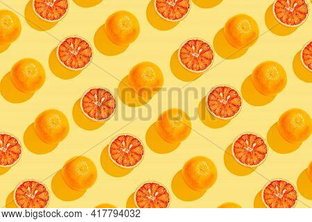 Creative Pattern Made With  Blood Orange On Yellow Background. Summer Fruit   Concept. Minimal Style