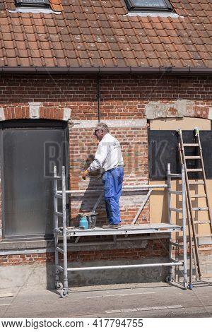 Sint Gillis Waas, Belgium, 21 April 2021, Elderly Craftsman Who Practices As A Painter Prepares The
