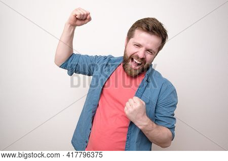 Cheerful, Happy Man, He Laughs And Makes A Joyful Hand Gesture. Winning The Lottery. Positive Emotio