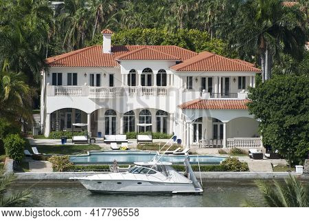 The Luxury House With A Private Yacht On Residential Palm Island In Miami (florida).