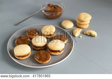 Alfahores Cookies On A Gray Plate On A Gray Background. Traditional Homemade Biscuits. Homemade Food