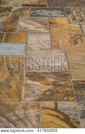A Vertical View Of Natural Cut Sandstone Walkway Of Various Colors And Textures Set In Cement In Rec