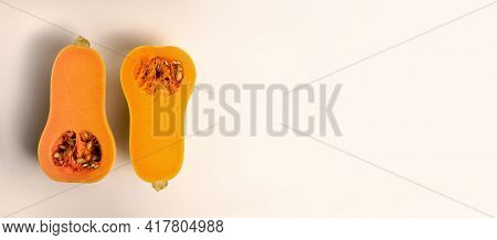 Banner With Place For Text.flatlay Of Fresh Butternut Squash Cut In Half Isolated On White Backgroun