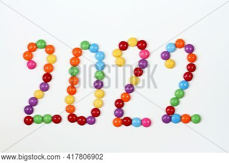 2022, Colorful Smarties On White Background. Chocolate Candies In Shape Of Buttons, Top View.