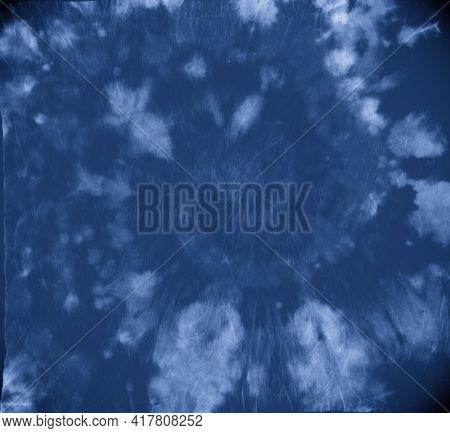 Indigo Tie Dye. Artistic Dyed Patterns. Abstract Spiral Kaleidoscope. Blue Tie-dye Roll. Circular Pa
